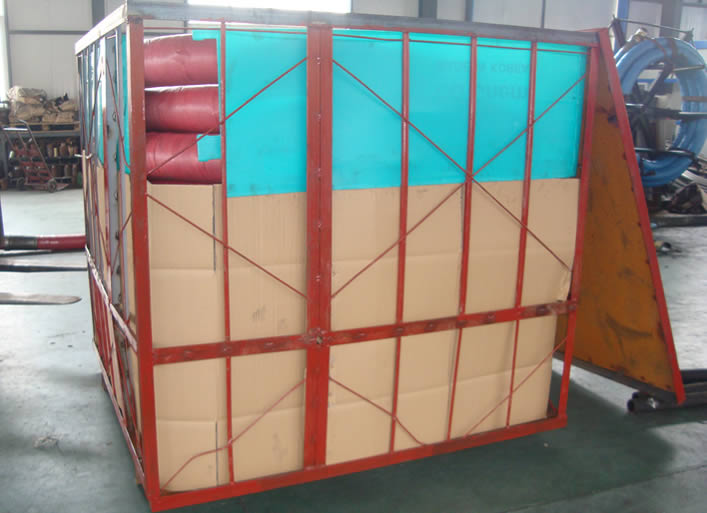 Concrete pump hoses are packaged in a large cage.
