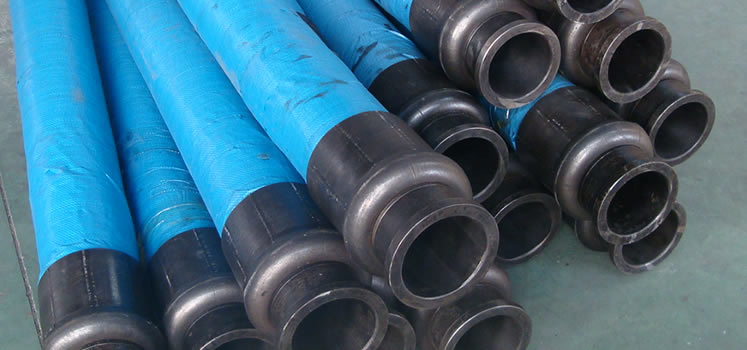 Many Blue Steel Wire Reinforced Concrete Pump Hoses Are On The Floor Of Work